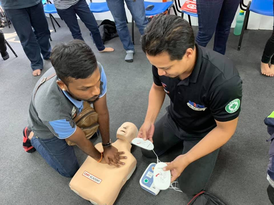 Participants mastering CPR Skills
